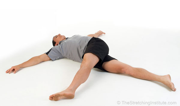 Photograph of stretching exercise from The Stretching Handbook, 3rd Edition.